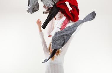 Woman Throwing Clothes
