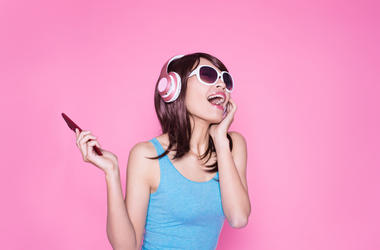Excited Woman WIth Headphones