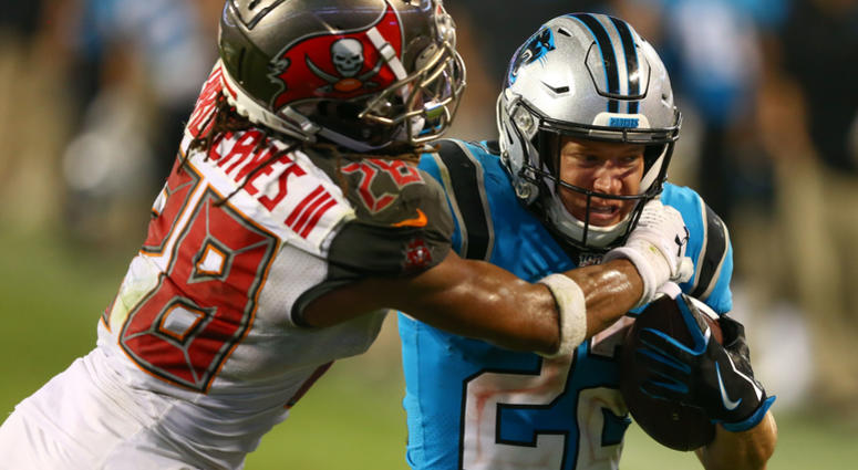 Carolina Panthers running back Christian McCaffrey (22) is shoved out of bounds by Tampa Bay Buccaneers cornerback Vernon III Hargreaves (28) during the fourth quarter at Bank of America Stadium