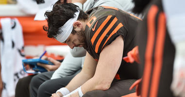 Cleveland Browns quarterback Baker Mayfield (6) bows his head on the bench during the first half against the Tennessee Titans at FirstEnergy Stadium