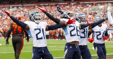 Tennessee Titans cornerback Logan Ryan (26) celebrates his interception with cornerback Malcolm Butler (21) and Tennessee Titans free safety Kevin Byard (31) against the Cleveland Browns during the fourth quarter at FirstEnergy Stadium
