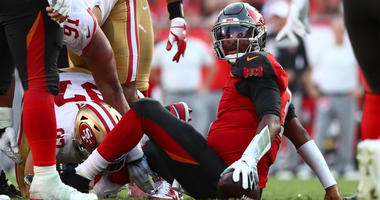 Tampa Bay Buccaneers quarterback Jameis Winston (3) looks on as he was sacked by San Francisco 49ers defensive end Nick Bosa (97) during the second half at Raymond James Stadium