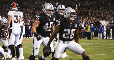 Oakland Raiders running back Josh Jacobs (28) celebrates after scoring a touchdown against the Denver Broncos during the fourth quarter at Oakland Coliseum