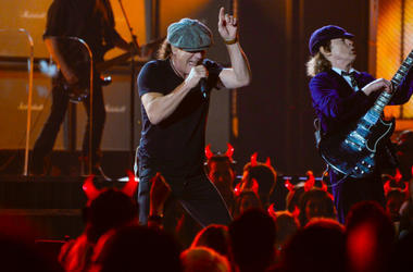 """AC/DC lead vocalist Brian Johnson (left) and guitarist Angus Young performs \""""Rock or Bust\"""" and \""""Highway to Hell\"""" at the 57th annual Grammy Awards at the Nokia Theatre."""