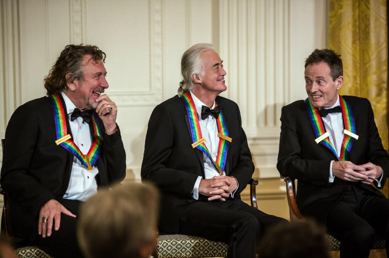 Robert Plant, Jimmy Page, and John Paul Jones (L-R) of the band Led Zeppelin attend the Kennedy Center Honors reception at the White House on December 2, 2012