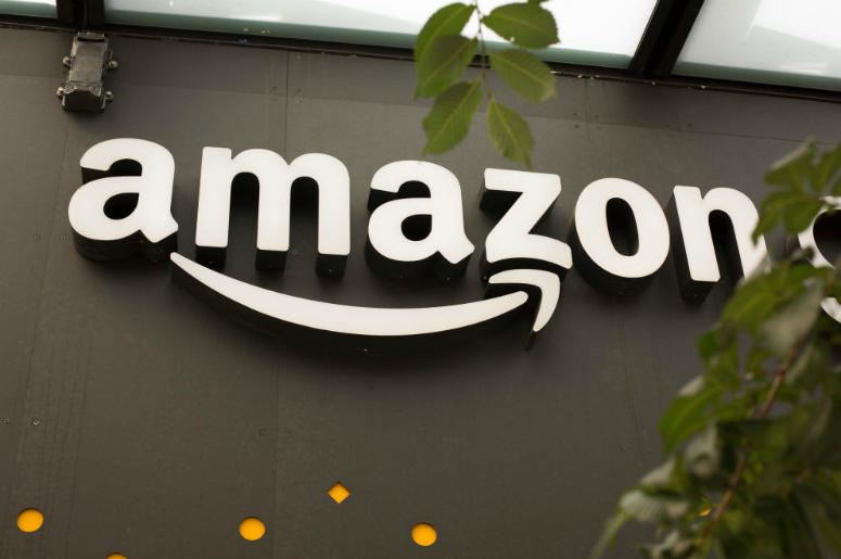 A portion of the sign advertising Amazon Go is seen outside the grocery store's location on June 16, 2017 in Seattle, Washington. Amazon announced that it will buy Whole Foods Market, Inc. for over $13 billion dollars.