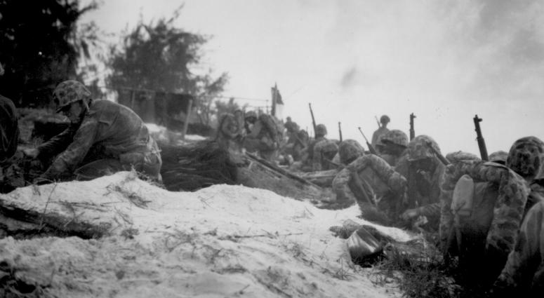 Negro assault troops await orders D-day to attack enemy shortly after they had come ashore at Saipan in the Marianas