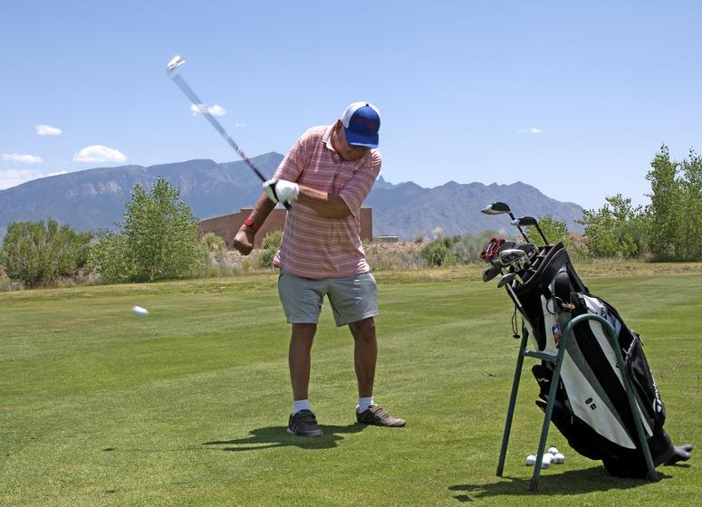 U.S. Army Veteran Joe Martinek uses an adaptive swing at the Twin Warriors Golf Club, Bernalillo, New Mexico, while participating in the New Mexico VA Health Care System's adaptive sports program
