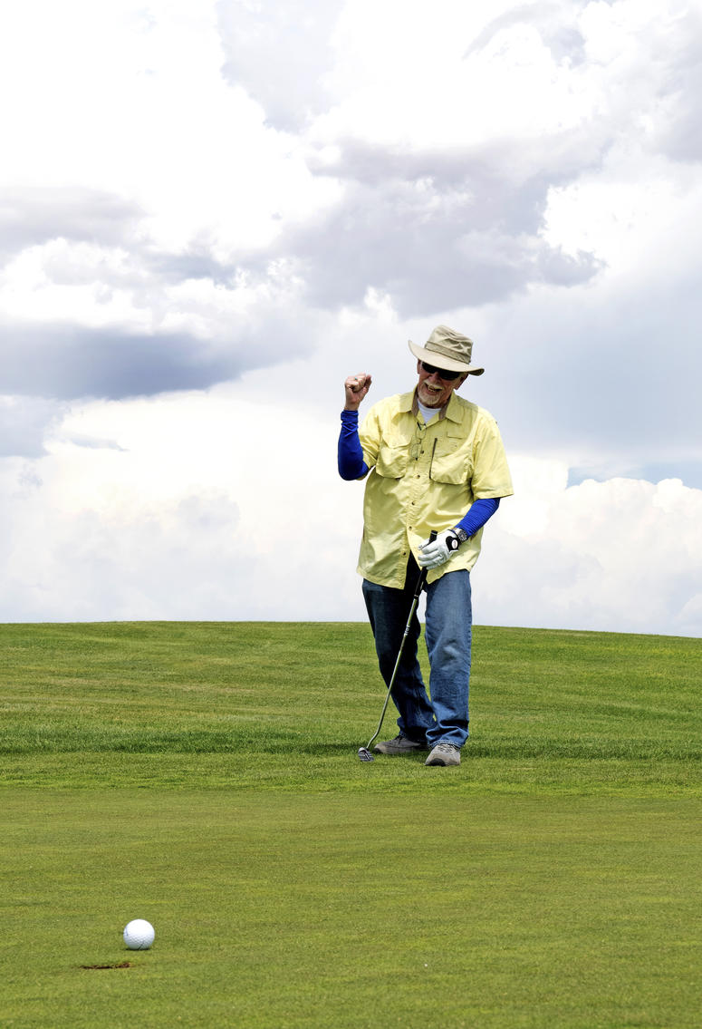 U.S. Army Veteran Henry Davis celebrates as his ball is about to go into the hole at the Twin Warriors Golf Club, Bernalillo, New Mexico.