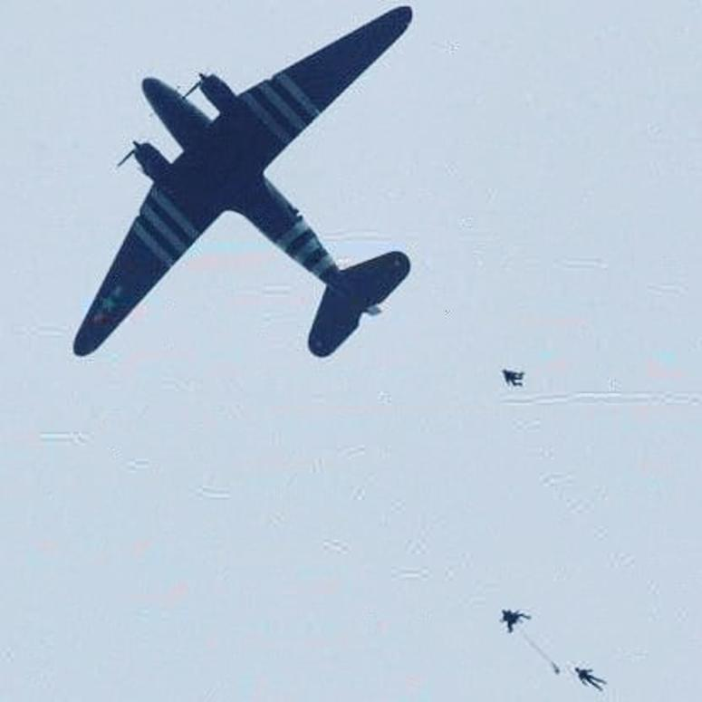 Jumpers exit a C-47 over Normandy on the 75th Anniversary of D-Day