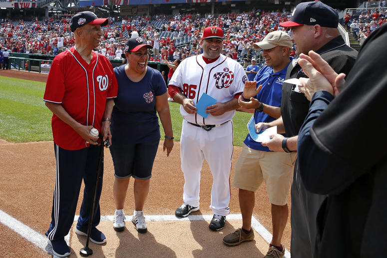 World War II veteran Ellsworth Hutchinson, Jr. delivers game ball