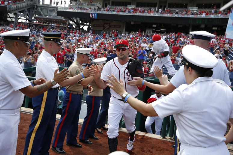 """Nationals first baseman Ryan Zimmerman takes field through """"lineup tunnel"""" of honored military members"""