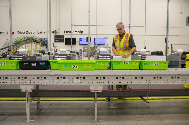 Made-on-demand and Books-on-Demand technology at the Amazon facility in Middletown. News Amazon Tour.