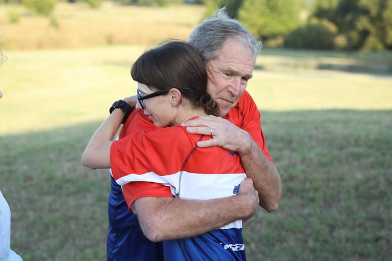 President George W. Bush hugs a biker