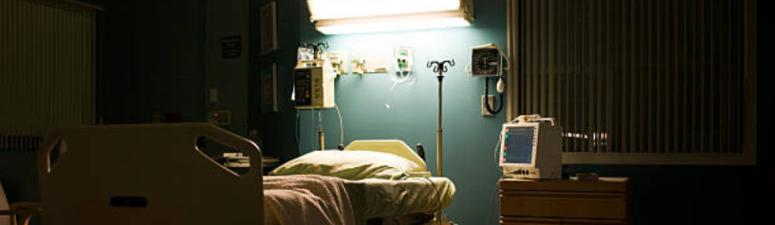 Empty, dark hospital room