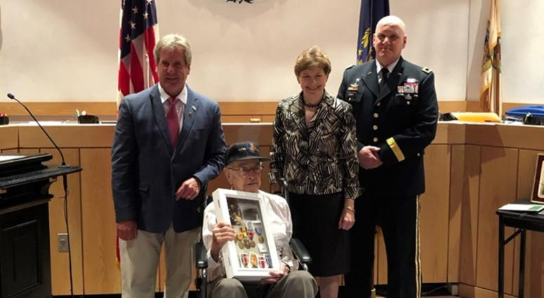 Democratic Sen. Jeanne Shaheen, Portsmouth Mayor Jack Blalock and Brigadier General William Conway of the New Hampshire Army National Guard awarded several medals to Antonio Vaccaro Friday in Portsmouth.