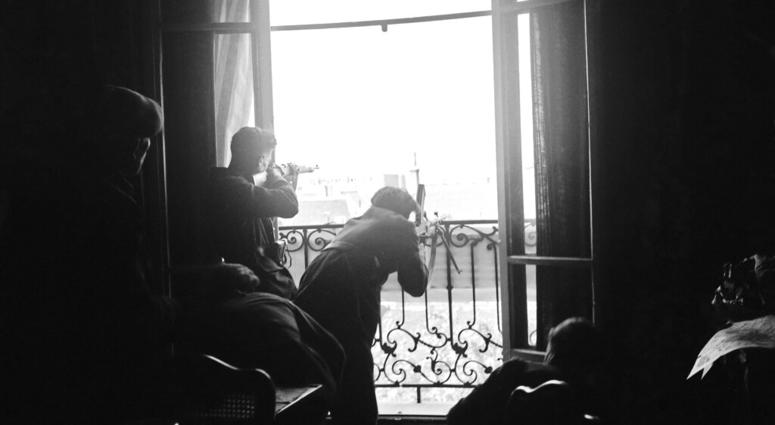This Aug. 26, 1944 file photo shows members of the French Forces of the Interior (FFI) shoot at German snipers