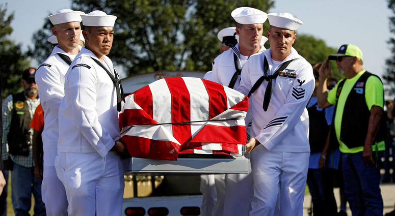 Sailors carry the casket of World War II veteran Herman White