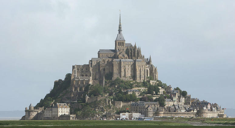 U.S. Army Special Forces commorate WWII with jump at Mont St. Michel, France.