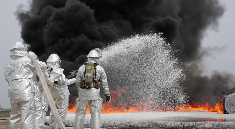 Marines with Bulk Fuel Company, 8th Engineer Support Battalion, 2nd Marine Logistics Group use Twin Agent Units to extinguish a blaze during a live fire training exercise aboard Marine Corps Air Station Cherry Point, Aug. 28, 2013. TAUs combine dry chemic