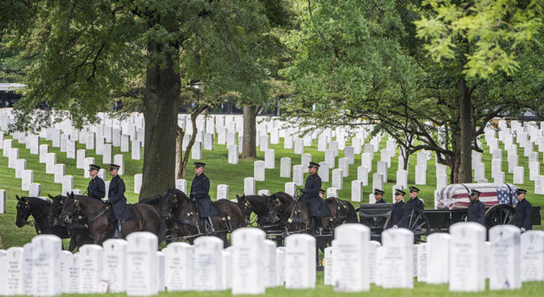 The 3d U.S. Infantry Regiment (The Old Guard) Caisson Platoon helps conduct a Full Honors Group Funeral Service for U.S. Army Air Forces Airmen missing from World War II in Section 60 of Arlington National Cemetery, Arlington, Virginia, June 27, 2018.