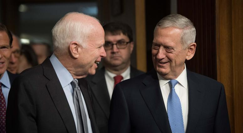 Jan 12, 2017; Washington, DC, USA; James N. Mattis, right, nominee for Secretary of Defense, arrives with Senator John McCain, R-Arizona, prior to the start of the confirmation hearing before the Senate Armed Services Committee.