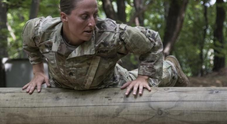 Sgt. Danielle Martin negotiates an obstacle during the 1-134th Cavalry Squadron's spur ride during annual training in the Republic of Korea