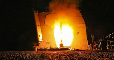 The guided-missile cruiser USS Monterey (CG 61) fires a Tomahawk land attack missile April 14.