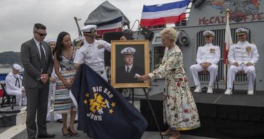 Cindy McCain is presented with a painting of her husband during the 25th anniversary of the ship's commissioning