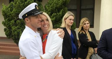 Navy Special Operations Chief Edward Gallagher, left, hugs his wife, Andrea Gallagher, after leaving a military courtroom on Naval Base San Diego.