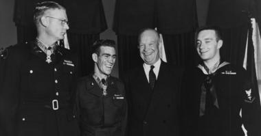President Dwight D. Eisenhower poses with three men at White House in 1954 including Hospital Corpsman 3rd Class William Charette