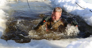 A student in the Cold-Weather Operations Course (CWOC) Class 18-04 participates in cold-water immersion training as part of the course training Feb. 14, 2018, at Fort McCoy, Wis.
