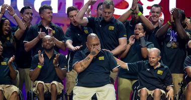 Army Staff Sgt. Mathew Lammers reacts to being named to receive the Heart of the Team Award for Team Army