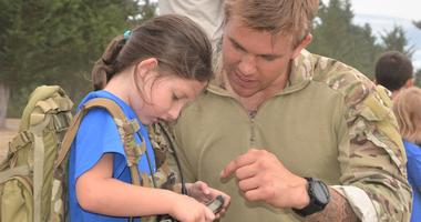 Service member with child