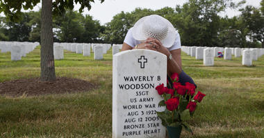 Joann Woodson at the grave site of Cpl. Waverly B. Woodson Jr. at Arlington National Cemetery in Arlington, Va.