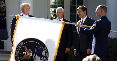 President Trump watches as the Space Command flag is unfurled at the White House.