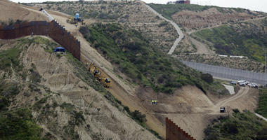 n this March 11, 2019 photo, construction crews replace a section of the primary wall separating San Diego, above right, and Tijuana, Mexico, below left, seen from Tijuana, Mexico.