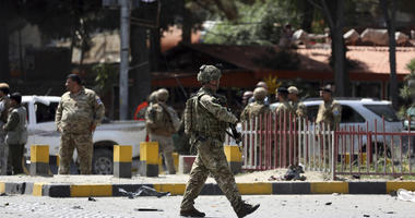 Resolute Support (RS) forces and Afghan security personnel inspect the site of a car bomb explosion in Kabul, Afghanistan, Thursday, Sept. 5, 2019.