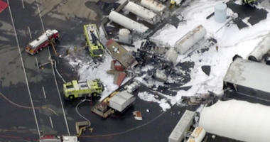 In this aerial image taken from video, emergency crews respond to where a World War II-era bomber B-17 plane crashed at Bradley International Airport in Windsor Locks, Conn., Wednesday, Oct. 2, 2019