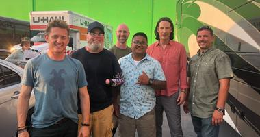 Military veterans pose with actors Keanu Reeves, Bill Winter on the set of the new Bill and Ted movie