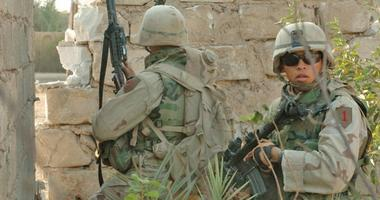 Soldiers from 1st Infantry Division, 3rd Brigade Reconnaissance Troop fight insurgents in Fallujah Iraq, Nov 2004