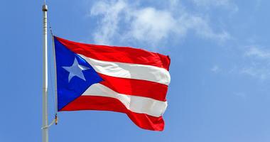 stock photo, Puetro Rico flag against blue sky