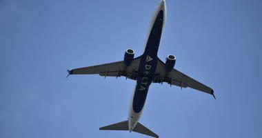 Delta Airline Aircraft Ascending into Blue Sky