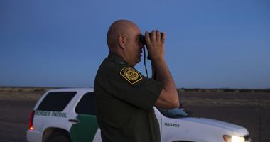 Border Patrol Supervisor Joe Romero looks for activity while on patrol along the border west of Columbus, New Mexico