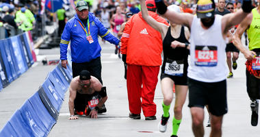 Apr 15, 2019; Boston, MA, USA; Micah Herndon crawls to the finish line of the 2019 Boston Marathon.