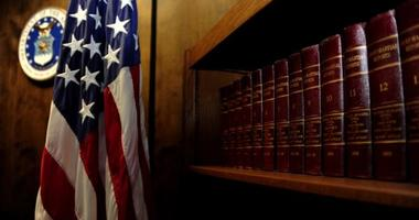 """Volumes of """"Court-Martial Reports"""" line the bookshelf located in the courtroom."""