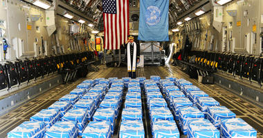 United Nations Command Chaplain Army Col. Sam Lee performs a blessing of sacrifice and remembrance on the 55 cases of remains returned by North Korea at Osan Air Base, South Korea, July 27, 2018.