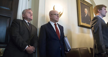 Former US National Security Advisor H.R. McMaster (C) attends a meeting at the White House in March.