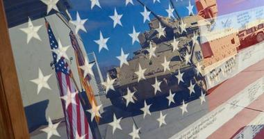 An encased flag is displayed during a ceremony held Sept. 11