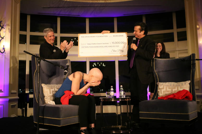 Steve Perry and Radio.com on-air personality Erin O'Malley during fundraising event